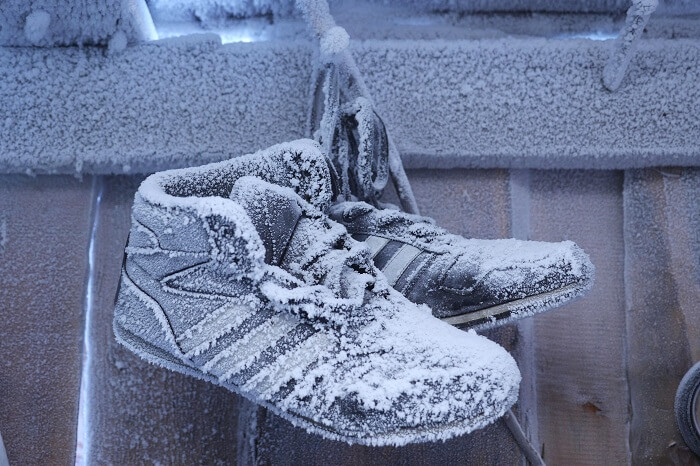 Snow-covered shoes hanging outside a house in Oymyakon in winters