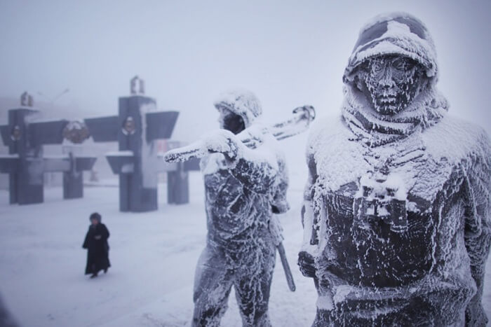 Snow-covered statues on the streets of Oymyakon in winters