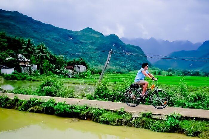 A tourist takes a cycling tour of Mai Chau