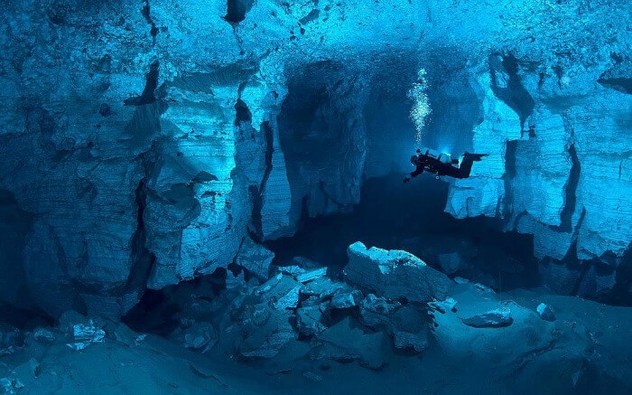 Light gypsum walls and clean cold water make the Orda cave in Russia one of the best places to go diving.