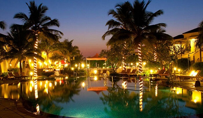 A late evening snap of the well-lit swimming pool area at the Royal Orchid Beach Resort and Spa