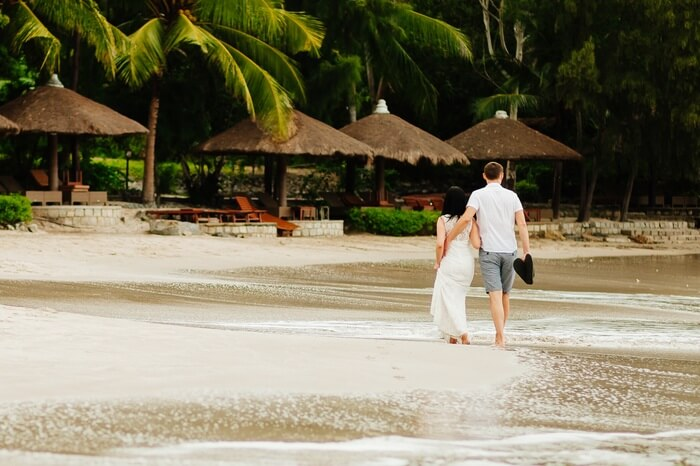 A couple walks on the shore at a beachfront resort in Vietnam