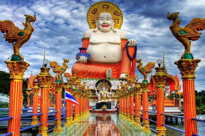 The Smiling Buddha statue at Wat Plai that is one of the popular tourist attractions in Koh Samui