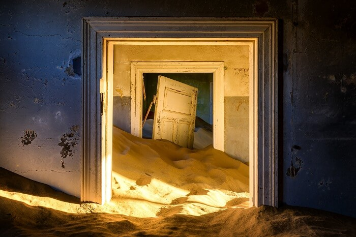 Building taken over by sand at the former diamond mining town of Kolmanskop in Namibia