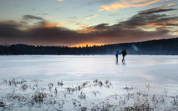 Couple on a frozen lake