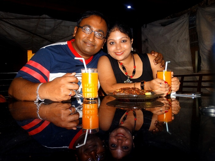 Suvankar with his wife inside the houseboat