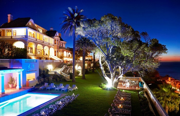 The pretty gardens and poolside deck of the Ellerman House
