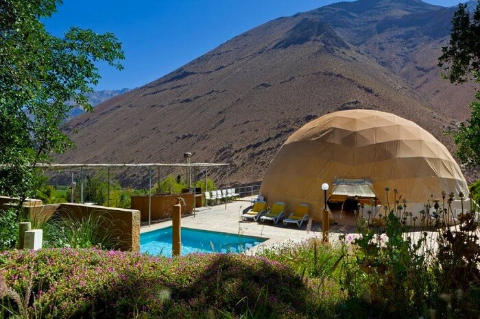 The swimming pool and a tent room at the Astronomic Hotel in Chile