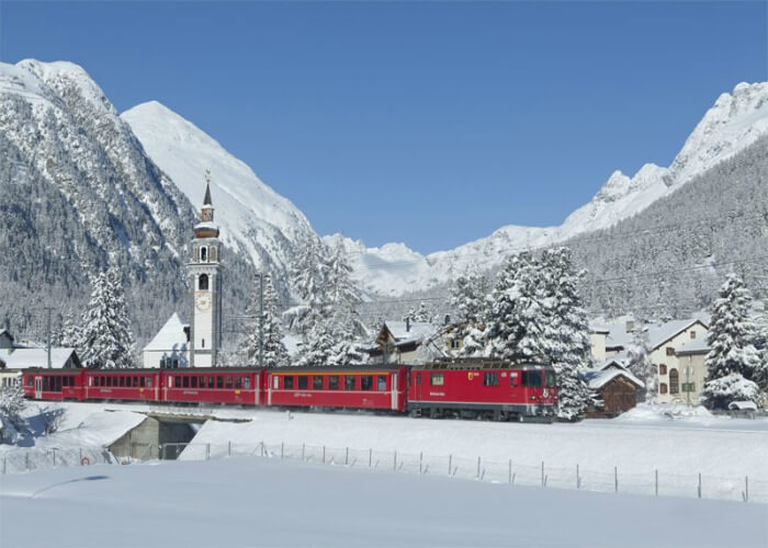 The Glacier Express passing through scenic mountain trails