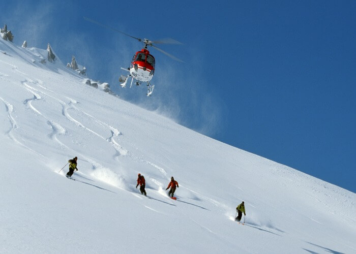 Experience the thrill of Heli Skiing in Manali, one of the best things to do in Manali during snowfall