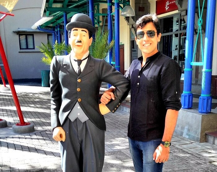 Sumit with Charlie Chaplin statue