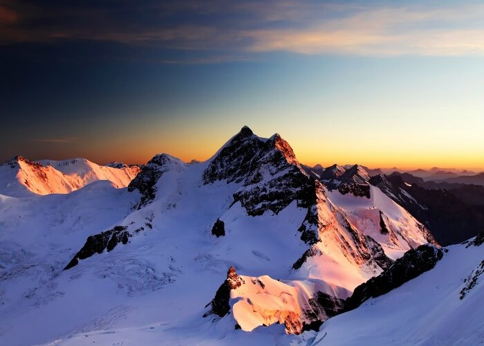 The snowy peaks of Jungfraujoch turned into a play of colours at dusk