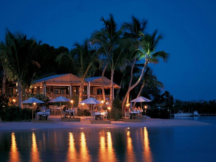 Shacks by the sea at Little Palm Island Resort & Spa