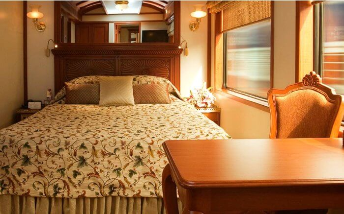 Interiors of deluxe room in Palace On Wheels