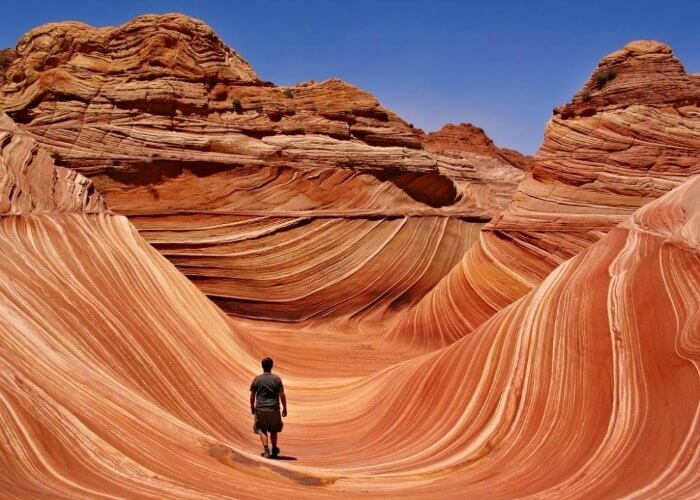 Watch the wavy rock formations in Arizona