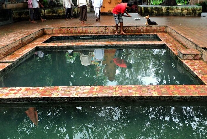Tourists enjoy bathing at the hot springs and pools of Akoli