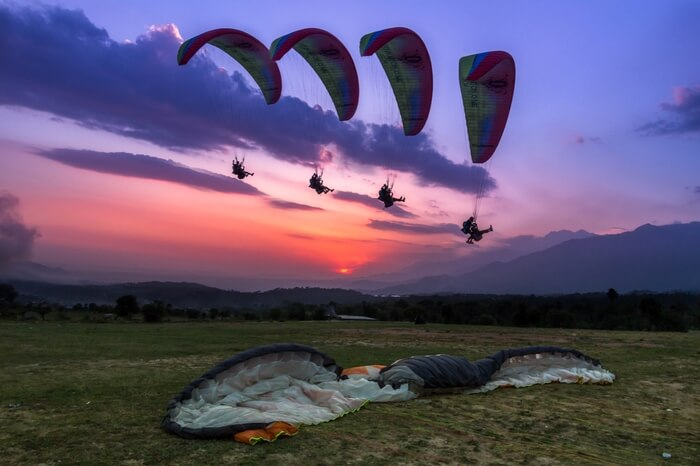 Paragliders soaring up high in the sky in Bir Billing