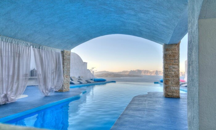 A natural outdoor pool at Astarte Suites