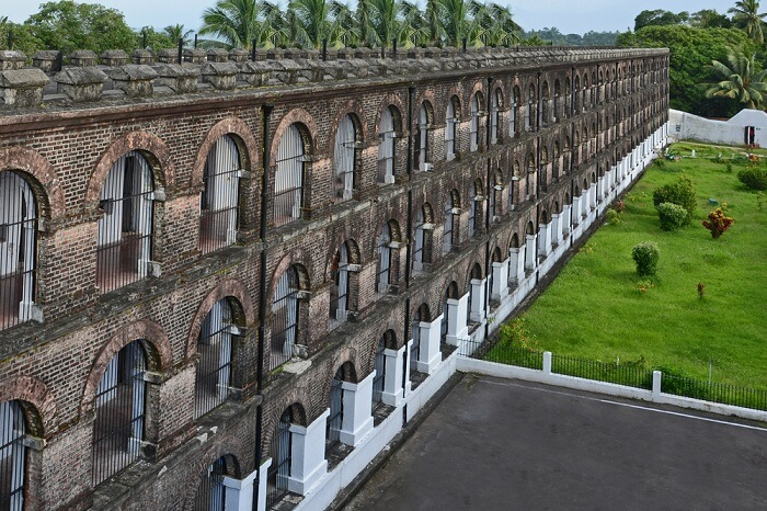 An aerial shot of the lawn and the jail building at the Cellular Jail in Port Blair