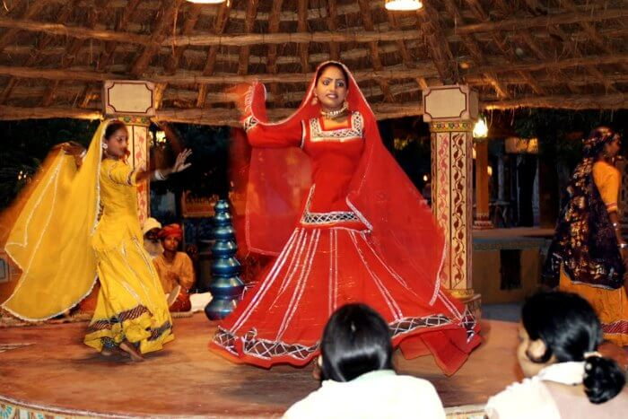 Visitors being treated to a lively folk dance at Chokhi Dhani