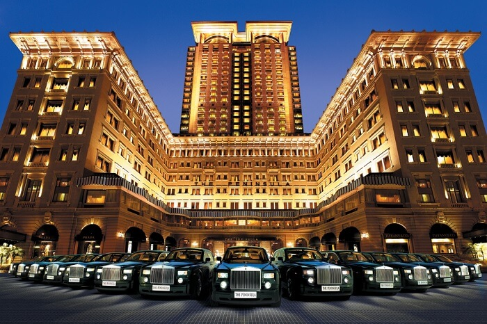 A fleet of Rolls Royce Phantom lined up in front of the Peninsula hotel that is one of the best luxury hotels in Hong Kong
