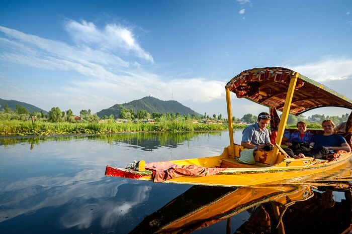 Tourists taking a shikara ride in Srinagar