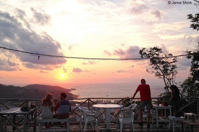 Guests relax and enjoy the sunset at the Wassa Homemade bar in Phuket