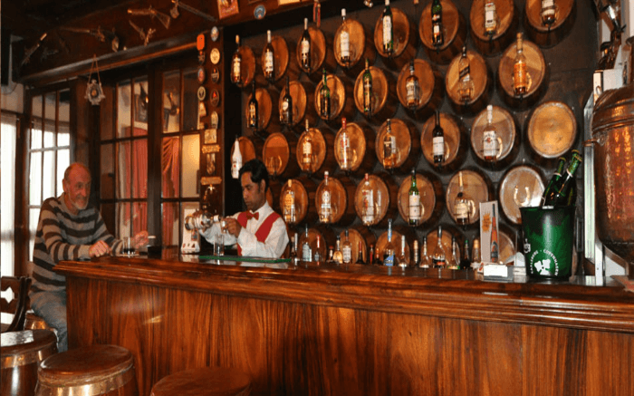 A bartender attends to a guest at the 19th Hole Pub