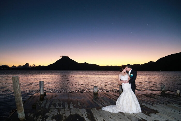 A honeymoon couple poses at lake Atitlán in Panajachel