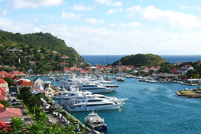 Aerial view at Gustavia Harbor with mega yachts