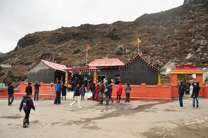 Tourists pay a visit to the Baba Harbajan Singh Mandir at the Nathula Pass