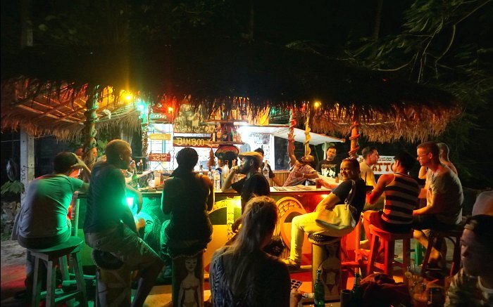 People enjoy live music and drinks at a party in Bamboo Bar