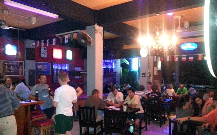 Tourists enjoying drinks at the Chilling Bar- a famous sports bar in Krabi town