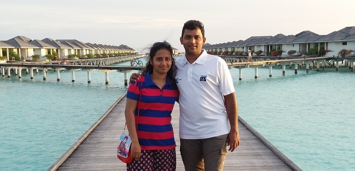 Karthik and his wife enjoy looking at the crystal clear waters of Maldives