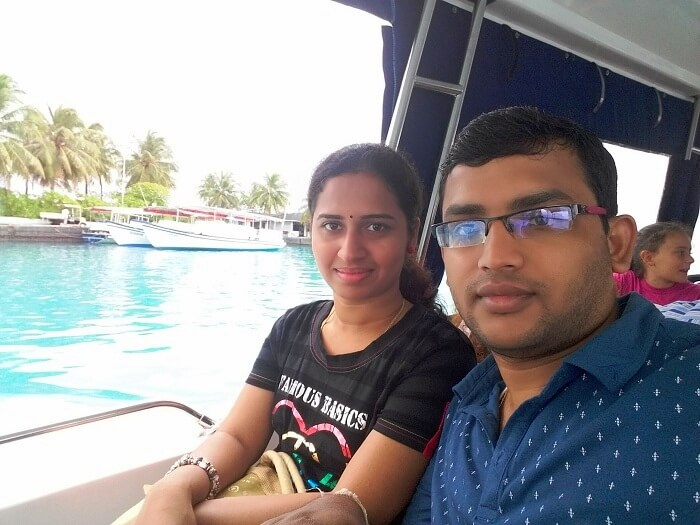 Karthik and his wife being transferred by boat to Maldives
