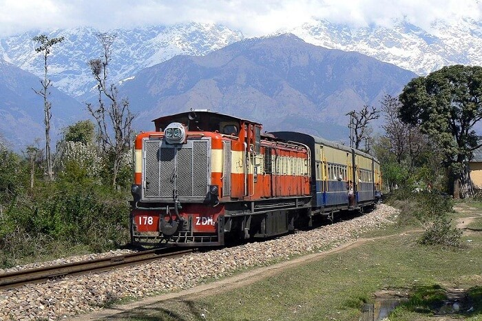 Dhauladhar Ranges in the backdrop of Kangra Valley Toy Train
