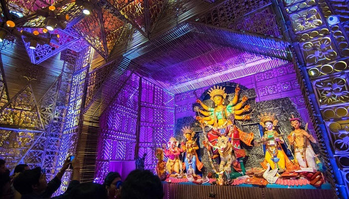 locals gather in a pandal to celebrate the festival of durga pooja