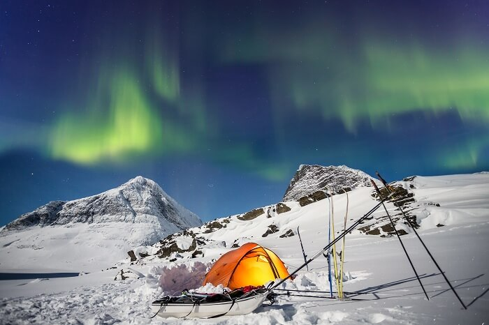 Camping under Northern Lights in Lapland