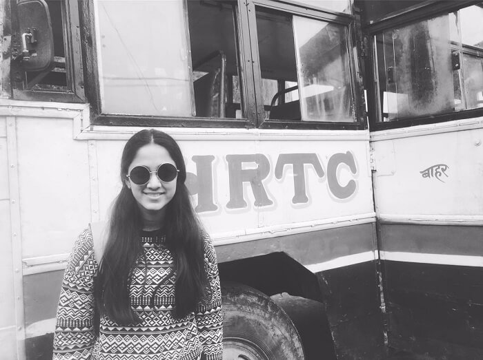 Lehan posing besides a bus in Spiti Valley