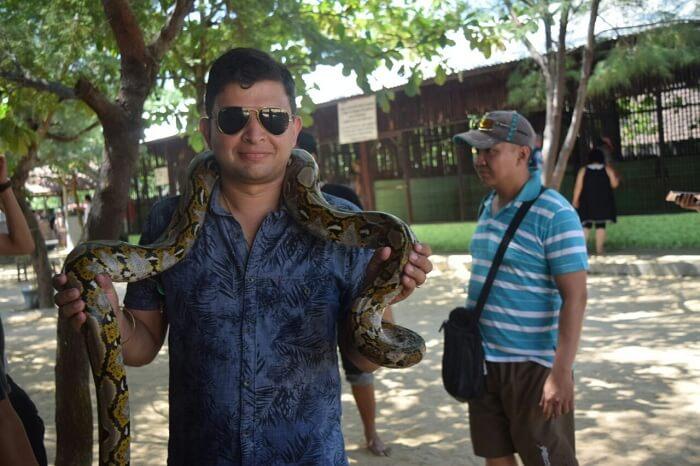 Mitaksh holding a python