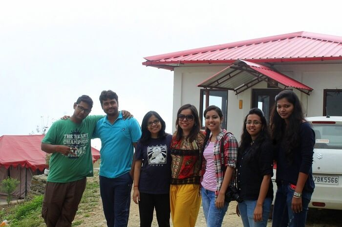 Kanika and her friends pose for a photo in Chakrata