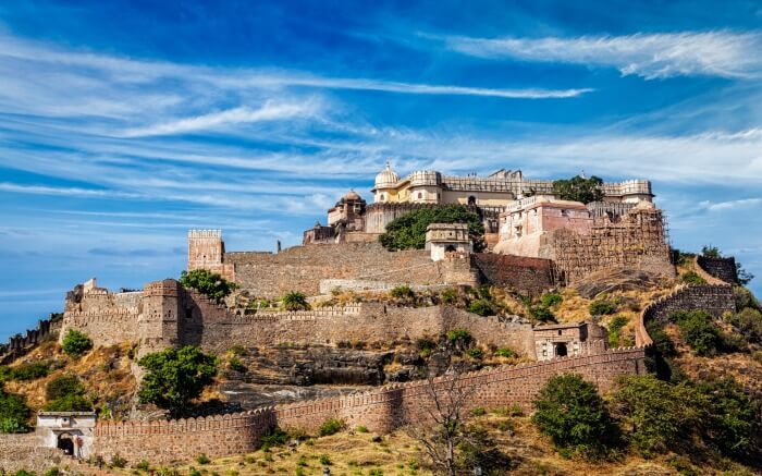 Kumbhalgarh Fort with its fortified walls proudly dominates the landscape of the city