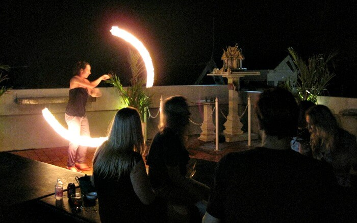 A fire dancer displays her skills at the Rooftop Bar in Krabi