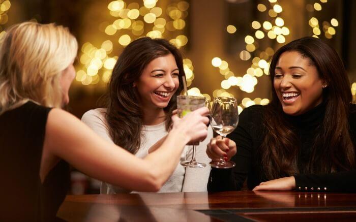 Three women drinking wine