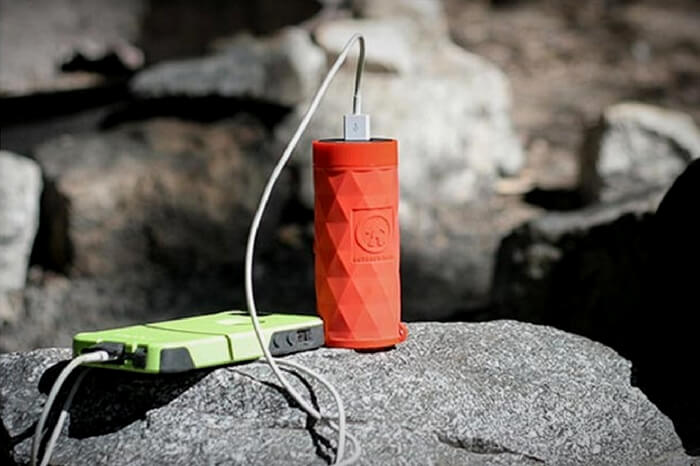 Bluetooth speaker cum flashlight that plays music and charging phone at the same time
