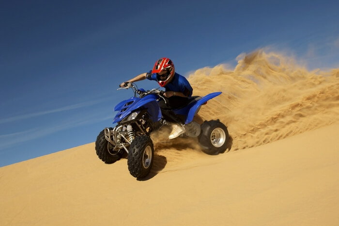 Man riding a quad bike near Sam Sand Dunes