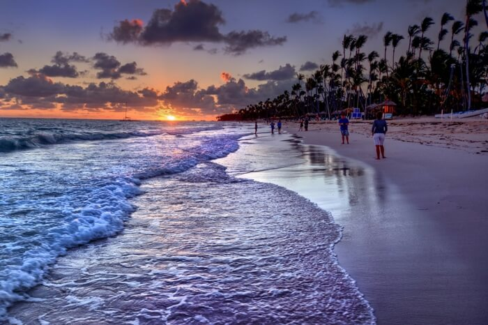 Waves along with the sun cast an orange hue on Radhanagar beach in Havelock island