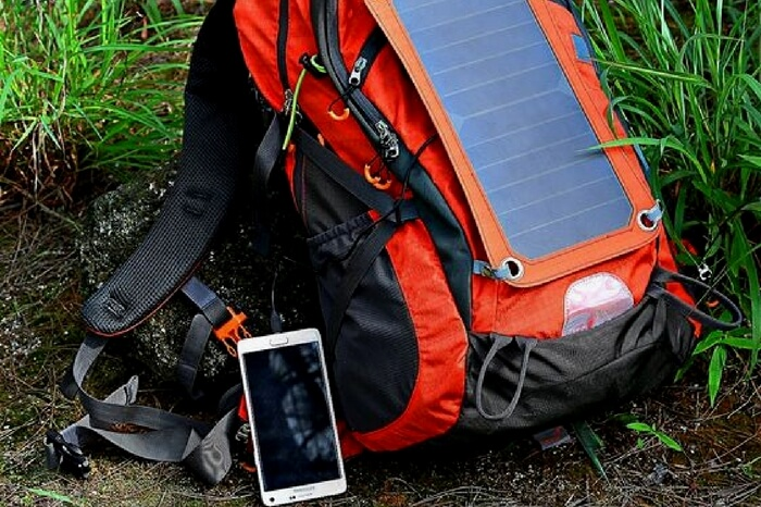 Gopax solar backpack charging a smartphone