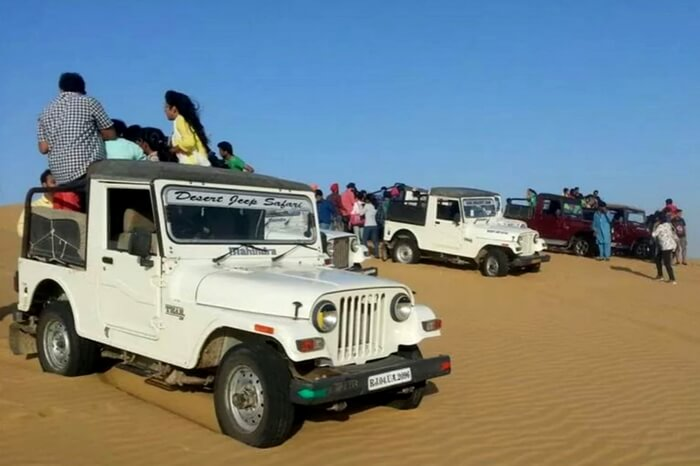 Visitors enjoying jeep safari in Jaisalmer