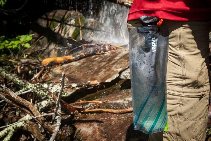 A traveler carrying a vapor microfilter bottle